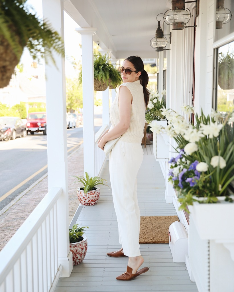 Dressed in cream on the front porch of the Life House, Nantucket